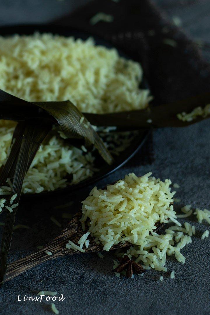 a spoonsful of yellow rice, nasi miyak