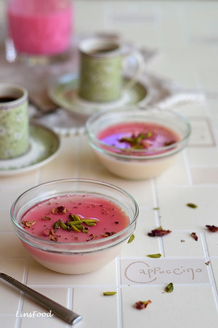 Panna cotta in 2 small bowls topped with rose syrup