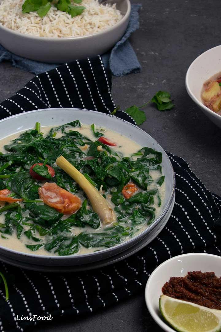 Spinach in coconut milk in blue bowl